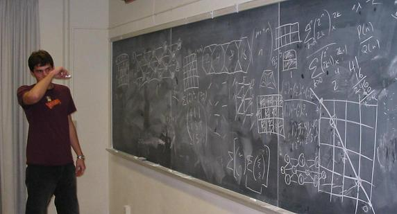 student at board full of equations
